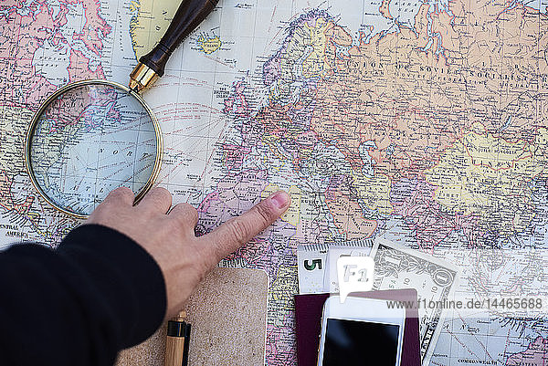 Travel planning with a world map  money  cell phone and magnifying glass