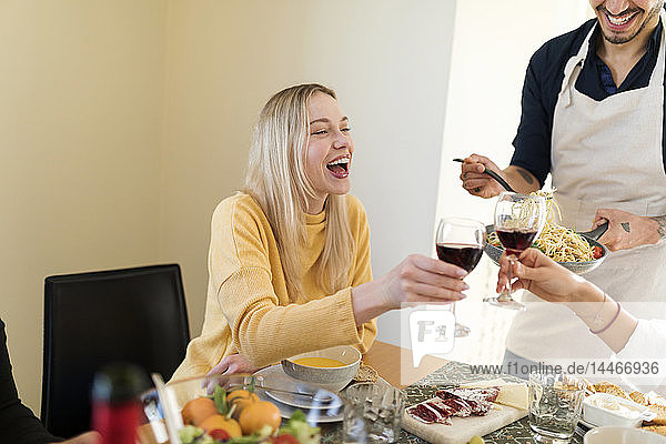 Friends having lunch together  drinking red wine