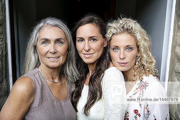 Portrait of three smiling women of different age