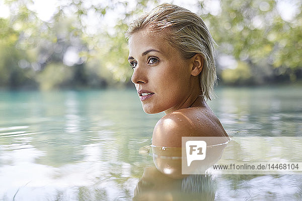 Beautiful woman bathing in a lake