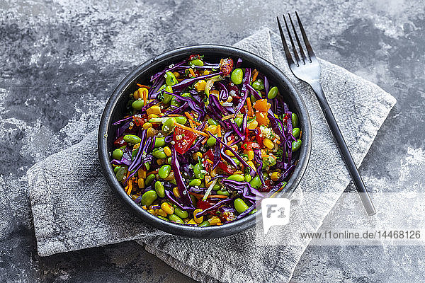 Salad with edamame  maize  red cabbage  carrot  bulgur  tomato