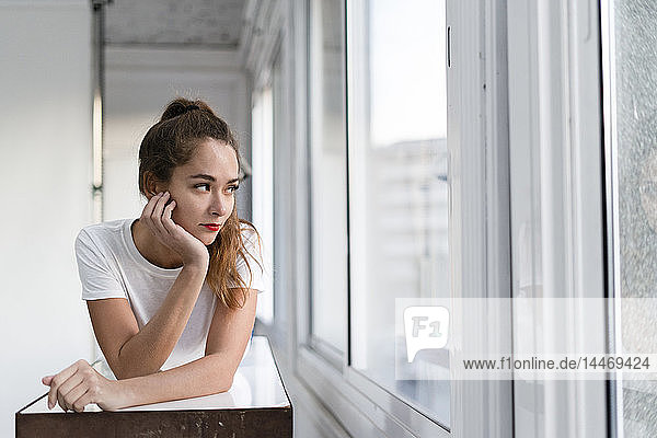 Portrait of a sexy aoung woman  lying on a bench