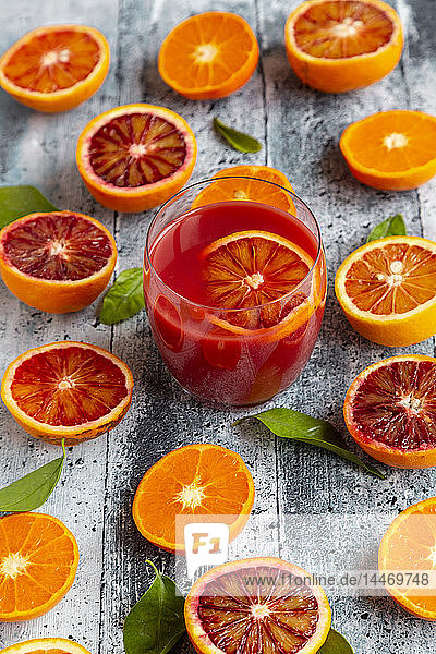 Halves of blood orangesHalves of blood oranges  tangerines and glass of blood orange juice
