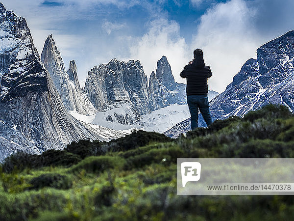 Chile,  Patagonia,  Torres del Paine National Park,  Cerro Paine Grande and Torres del Paine,  tourist photographing,  rear view