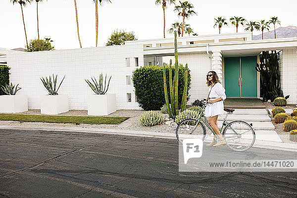 USA  California  Palm Springs  woman on bicycle on the street