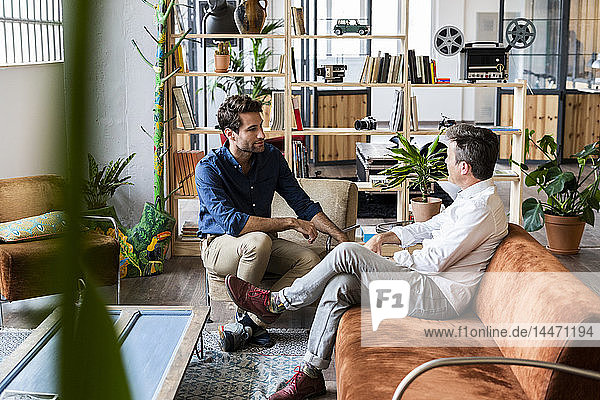 Two businessmen having a discussion in loft office