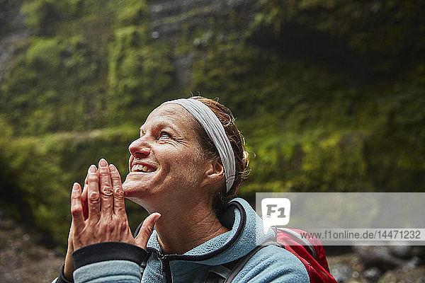 Chile  Patagonia  Osorno Volcano  portrait of woman admiring Las Cascadas waterfall