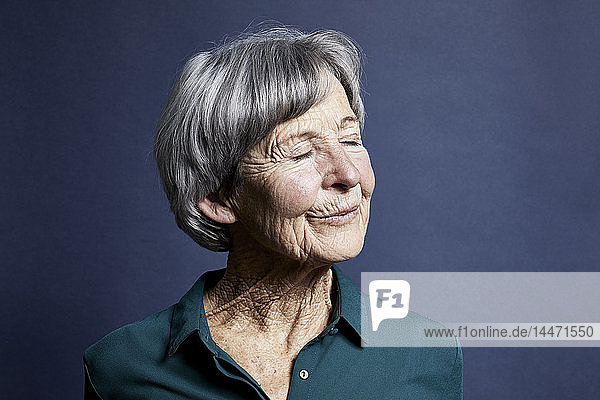 Portrait of smiling senior woman with eyes closed