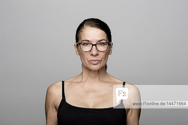 Portrait of serious mature woman wearing glasses