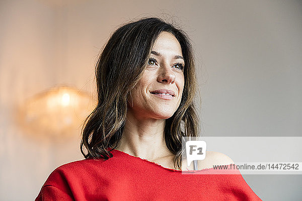 Portrait of a confident woma  wearing red pullover