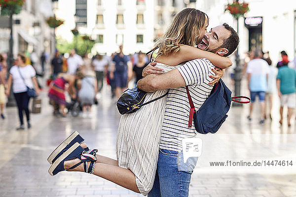 Spain  Andalusia  Malaga  happy couple hugging in the city