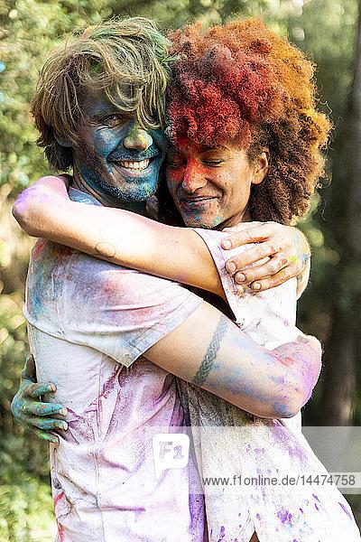 Affectionate couple celebrating Holi  Festival of Colors