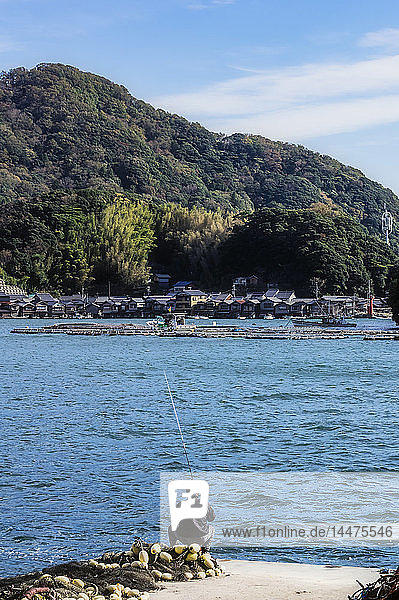 Japan  Kyoto Prefecture  fishing village Ine  townscape with angler