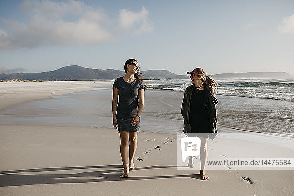 South Africa  Western Cape  Noordhoek Beach  two young women strolling on the beach