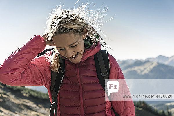 Austria  Tyrol  happy woman on a hiking trip in the mountains