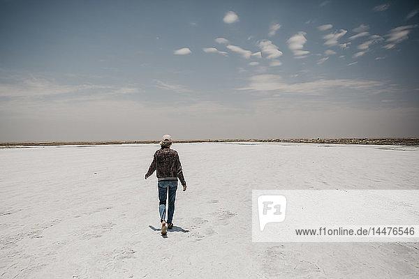 Namibia  Walvis Bay  woman walking on a salt plain