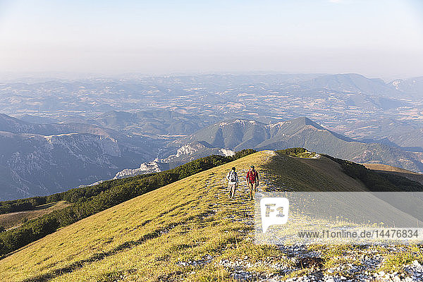 Italy  Monte Nerone  two men hiking on top of a mountain in summer