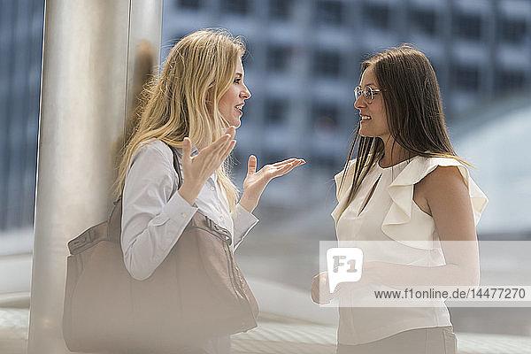 Two women talking in the city