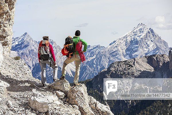 Italy  Cortina d'Ampezzo  couple with rope and climbing equipment looking at view