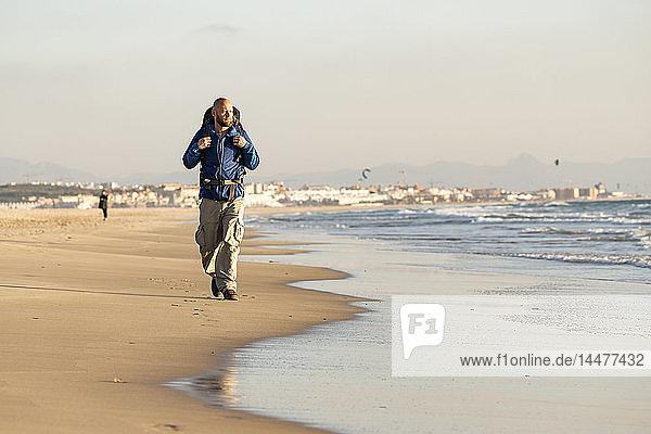 Spain  Andalusia  Tarifa  man during hiking on the beach