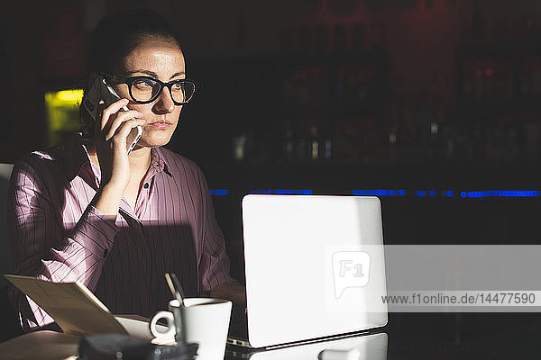 Woman working long hours  sitting in a coffee shop