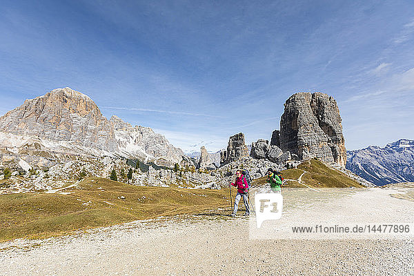 Italy  Cortina d'Ampezzo  two people hiking in the Dolomites mountain area