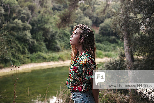 Young woman surrounded by nature