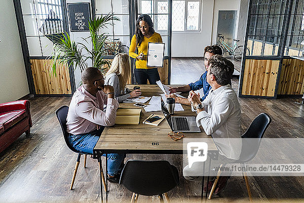 Businesswoman leading a presentation in loft office