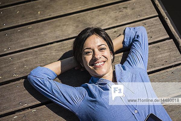 Mature woman taking a break  relaxing on a jetty
