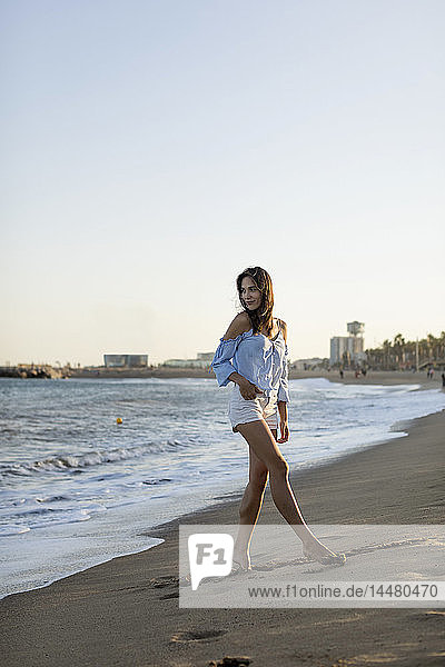 Portrait of a beautiful woman  walking on the beach