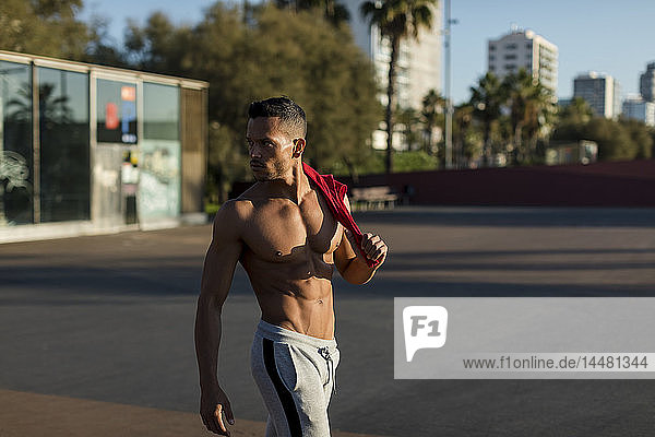 Portrait of a muscular man with bare chest  after workout