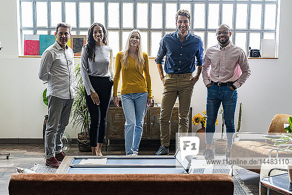 Portrait of confident business team in loft office
