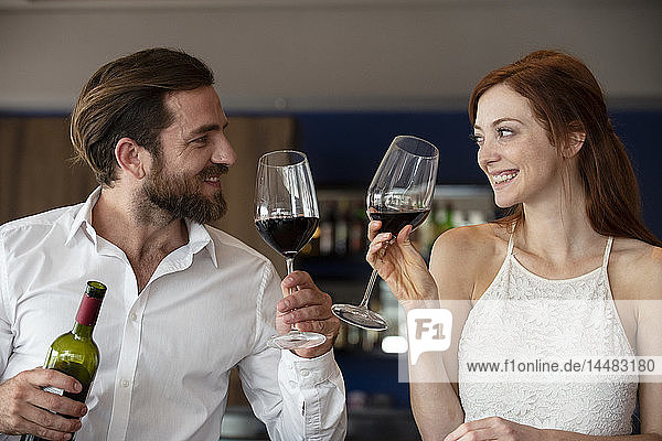 Mid adult couple holding wine glass