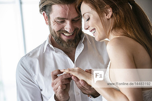 Close-up of man proposing to his girlfriend with a ring