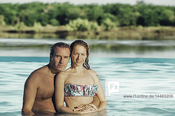 Couple enjoying in swimming pool