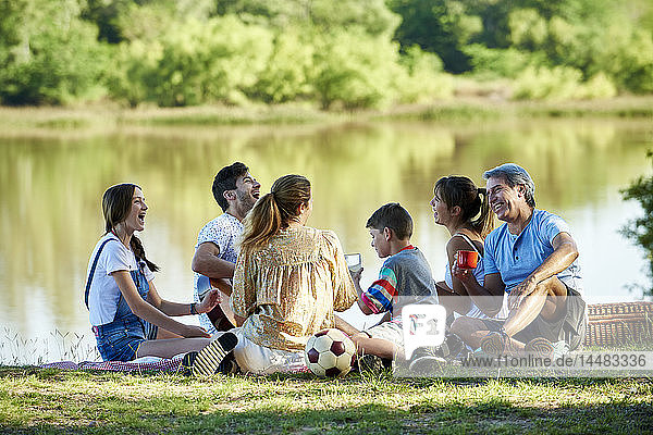 Family enjoying picnic near lake