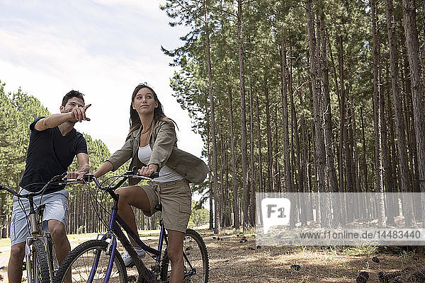 Young couple resting on bicycles
