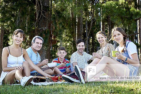 Portrait of family enjoying picnic