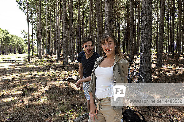 Young couple standing in forest