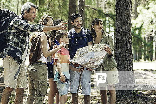 Family holding map in forest