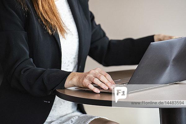 Businesswoman using laptop in hotel