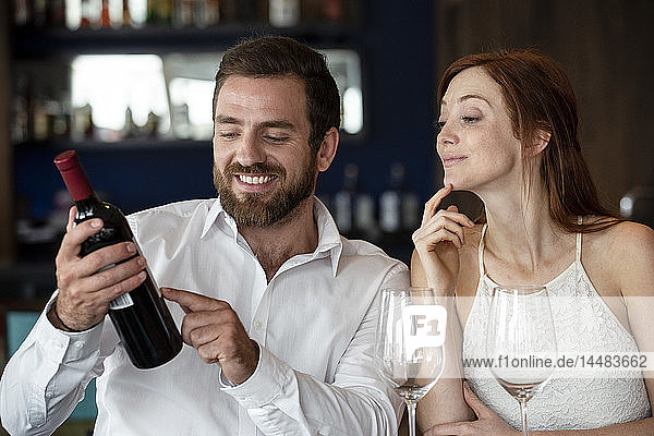 Mid adult couple sitting in bar