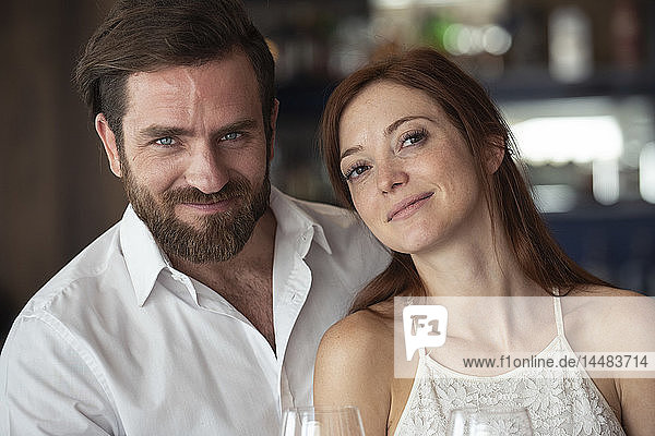Smiling couple sitting in bar