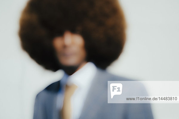 Defocused portrait well-dressed young man with afro