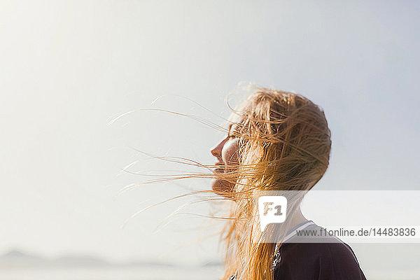Serene woman basking in sunshine Serene woman basking in sunshine