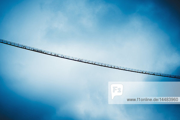 View from below suspension bridge against cloudy sky  Tyrol  Austria
