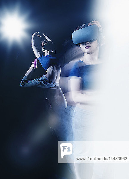 Multiple exposure female modern dancer wearing virtual reality simulator glasses