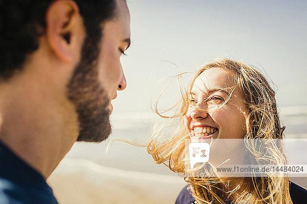 Happy couple on sunny beach