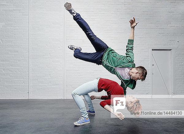 Modern aerialist dancers performing
