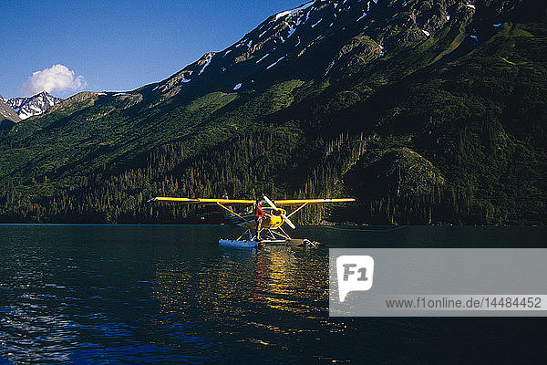 Fisherman Fishing from Float Plane on Lake Kenai Pen. AK
